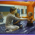 J.J. playes on a bouncy toy at preschool