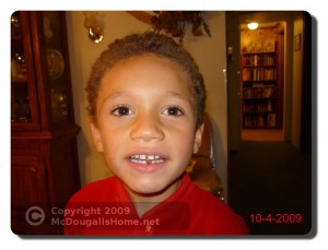 J.J. lost his first tooth.  Click the picture to see a larger view.